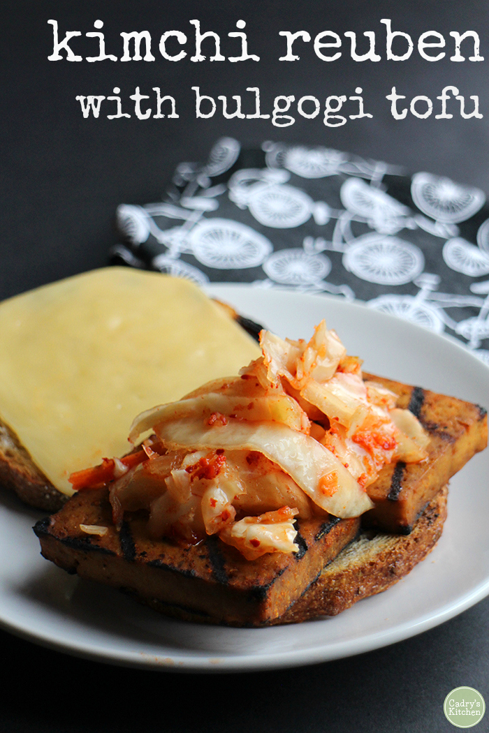 This kimchi reuben is packed with savory bulgogi tofu, spicy kimchi, and your choice of non-dairy smoked gouda or avocado slices. Loaded with flavor in every bite, this vegan sandwich truly satisfies. #vegan #kimchi #reuben #sandwich