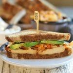 Sliced tofu sandwich with avocado and kimchi.