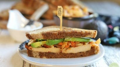 Sliced tofu sandwich with avocado and kimchi.