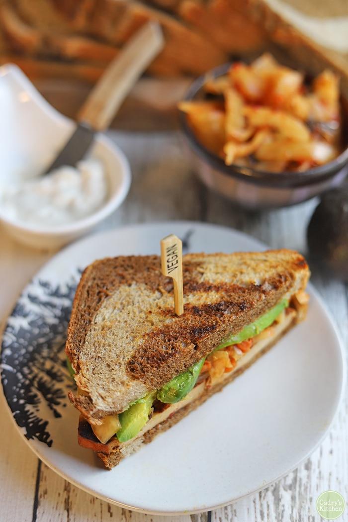 Bulgogi style sandwich with kimchi on plate.