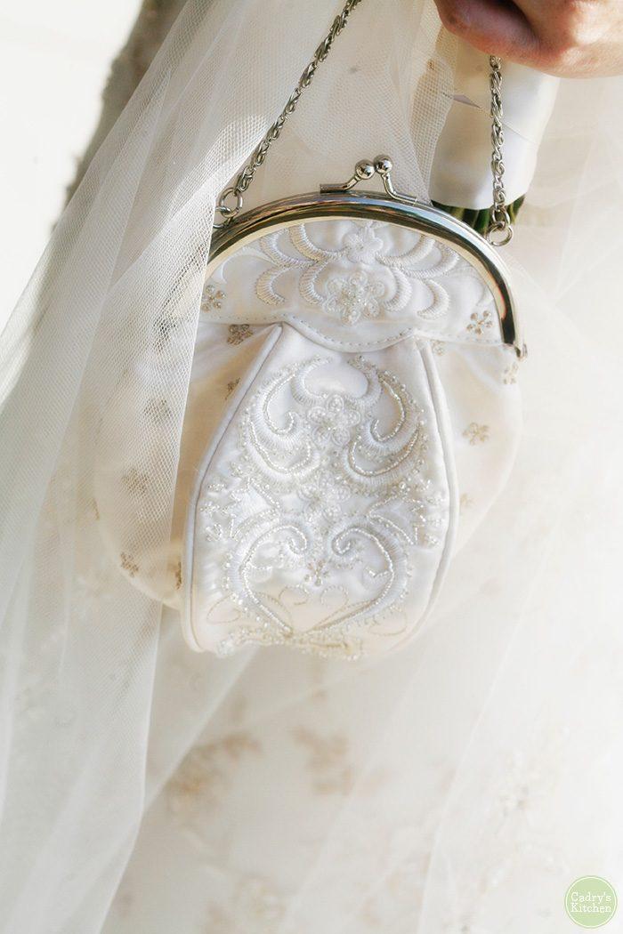 Bride holding satin purse.