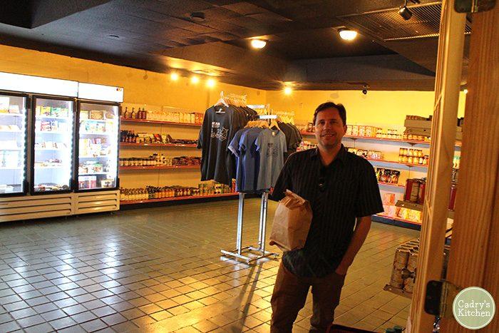 David posing in market area inside of Bean Vegan Cuisine.