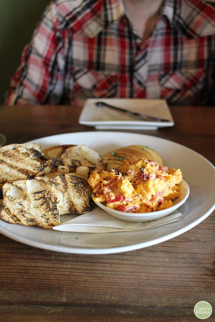 Pimiento cheese on table with grilled bread.