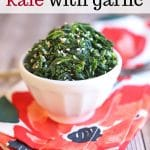 Text overlay: Easy sesame kale with garlic. Steamed kale with sesame seeds in bowl on flowered napkin.