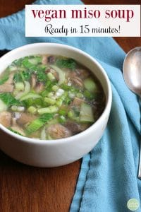 Vegan miso soup. Ready in 15 minutes. Bowl of miso soup with mushrooms, bok choy, and onions.
