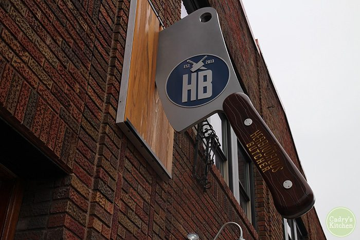 Herbivorous Butcher cleaver sign outside of building in Minneapolis.