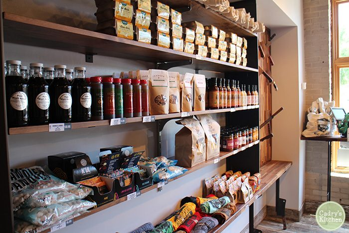 Products for sale along wall at Herbivorous Butcher.