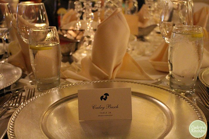 Name card on plate at wedding reception.