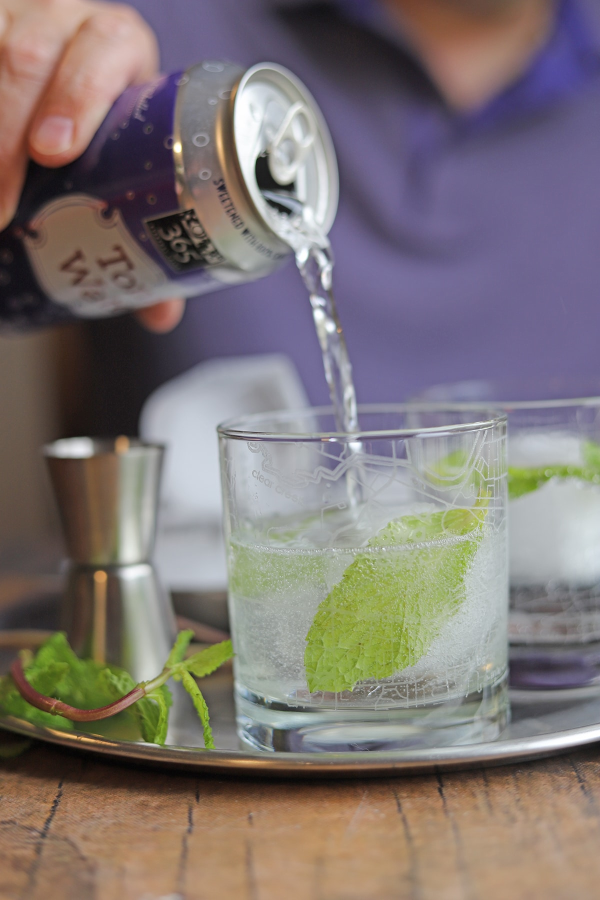 Tonic being poured into G&T.