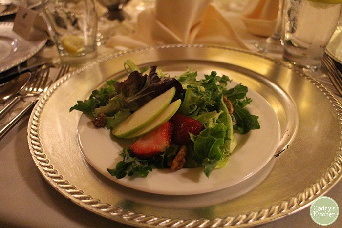 Salad with apples & strawberries at wedding reception.