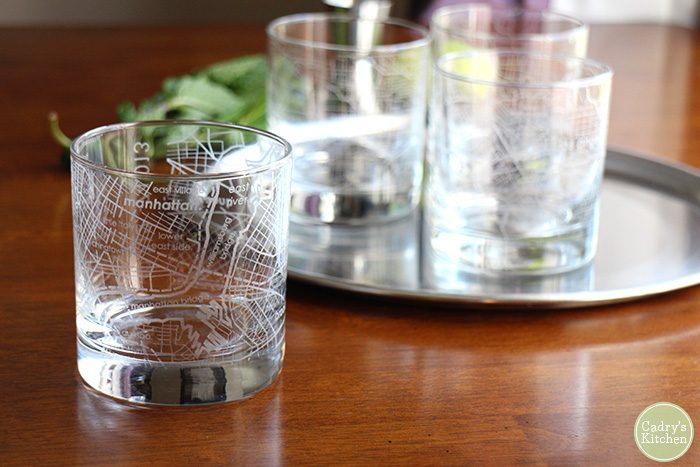 Map glasses from Uncommon Goods on table.