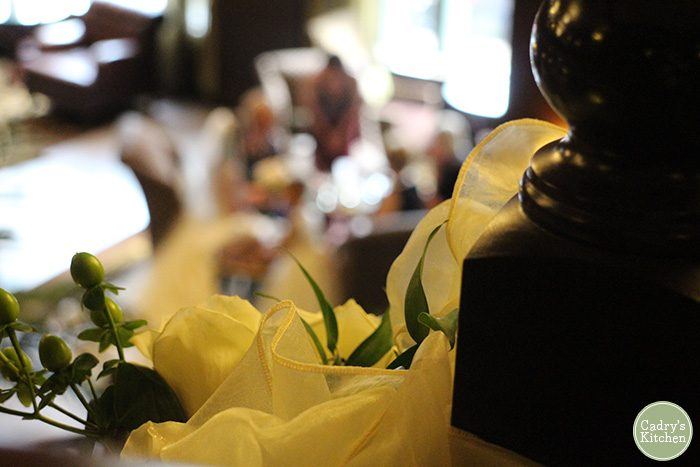 Gauzy ribbon and flowers at a wedding.