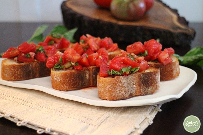 Ripe summer tomatoes have found their calling. Classic tomato bruschetta. There's a reason that it's beloved. | cadryskitchen.com