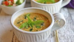 Vegan corn chowder in bowls with fresh basil garnish.