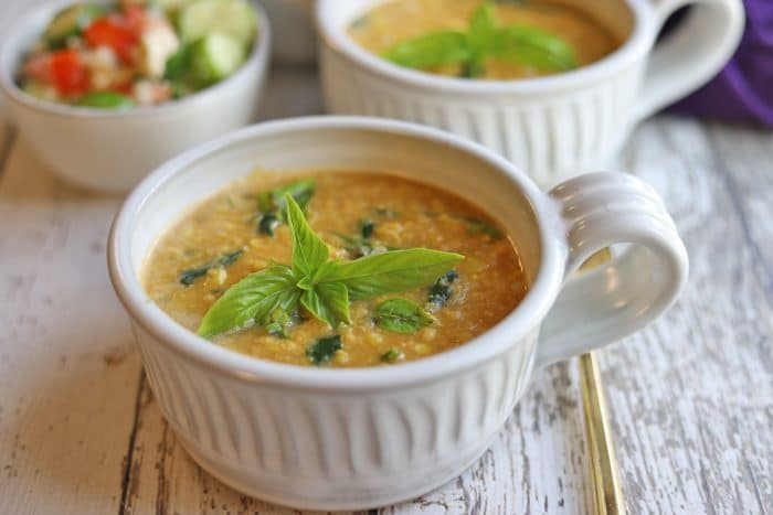 Vegan corn chowder in bowls with fresh basil garnish.