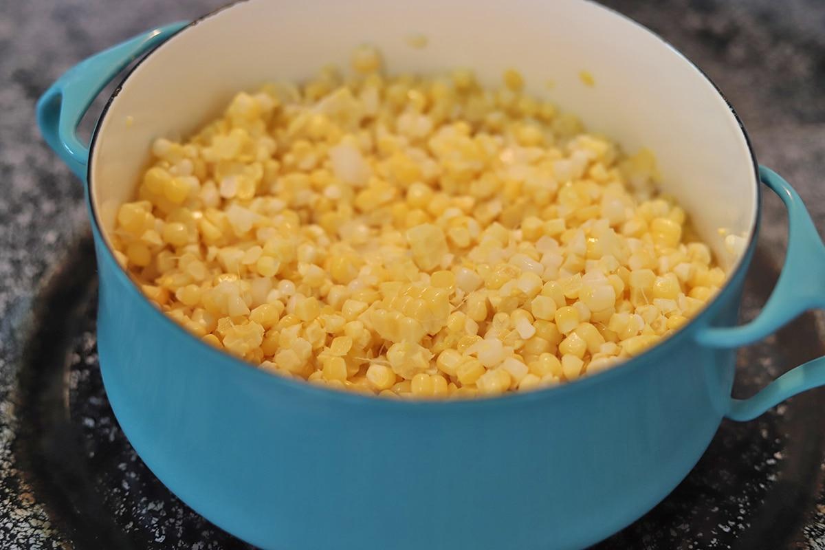 Fresh corn kernels in soup pot.