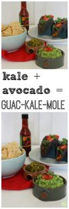 Kale guacamole in bowl with tacos and hot sauce.