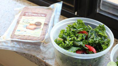 Kale salad in plastic tub. Wildwood tofu in packaging.