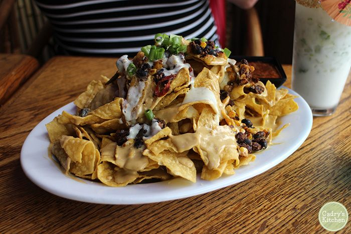 Platter of nachos with non-dairy queso.