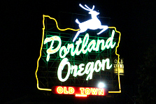 Portland, Oregon Old Town sign lit up at night.