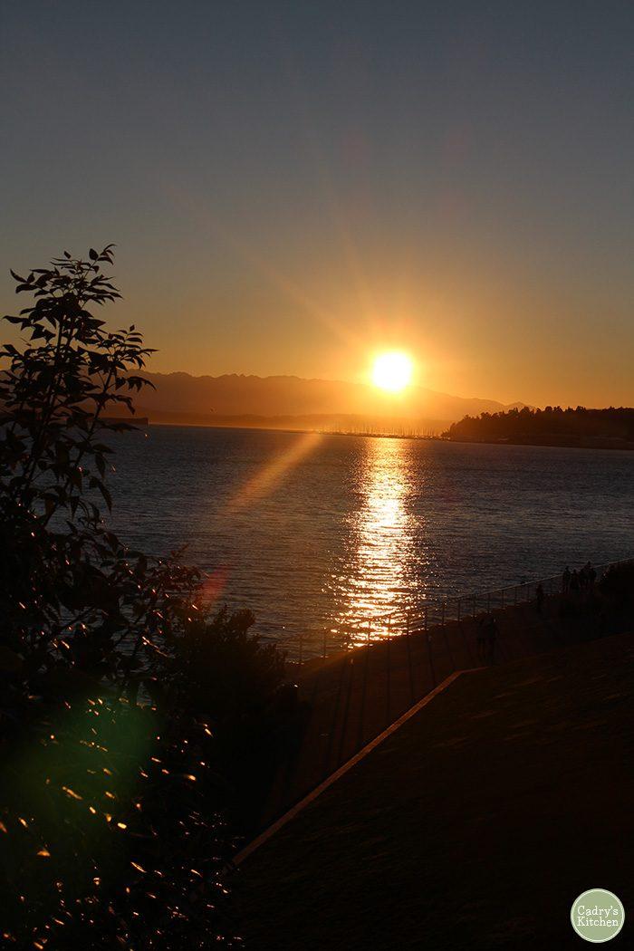 Sun setting on water in Seattle, Washington.