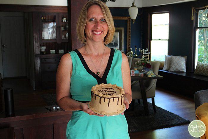 Cadry holding birthday cake.