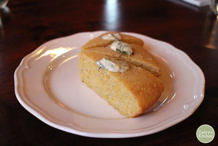 Cornbread slices on plate.