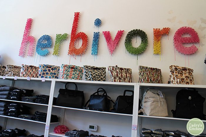 Interior Herbivore Clothing store - purses on wall.