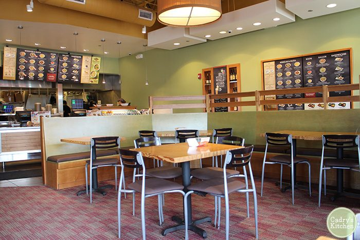 Interior Noodles & Company, counter & tables.