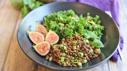 Kale, figs, and lentil salad in bowl.