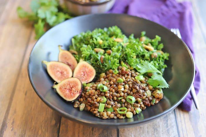 Kale, figs, and lentil salad in bowl.
