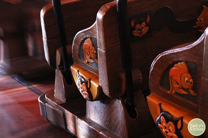 Wooden seats for Pinocchio ride at Disneyland.