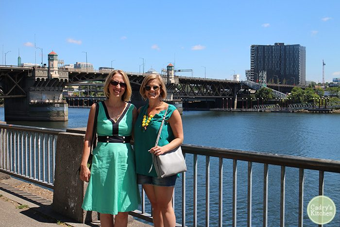 Cadry Nelson & Kristy Turner in front of Williamette River in Portland, Oregon.