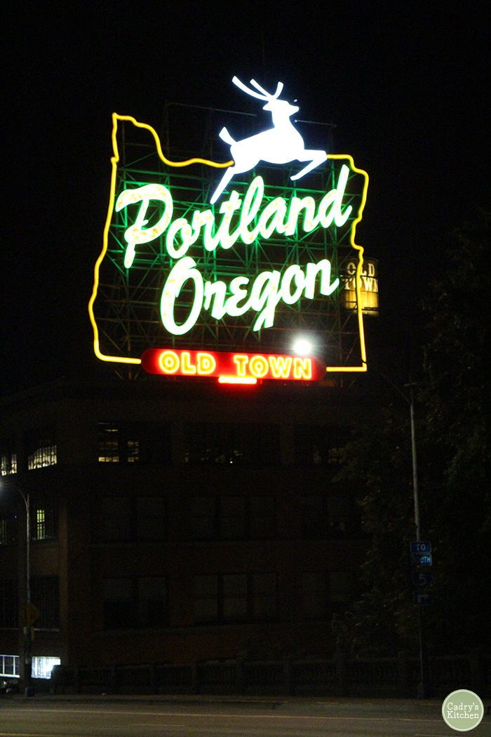 Portland Oregon Old Town sign lit up at night.