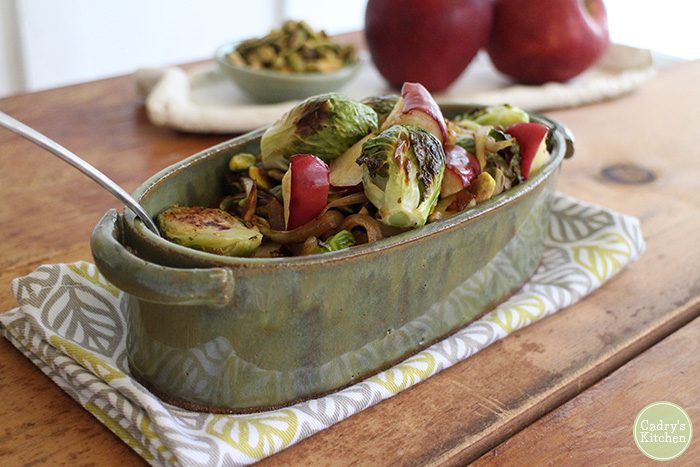 Roasted Brussels sprouts recipe with apples and caramelized onions & pistachios. A vegan side dish that the whole family will love. Great for Thanksgiving! | cadryskitchen.com