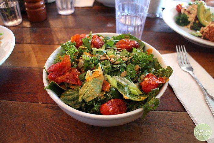Salad with pepitas and tomatoes.