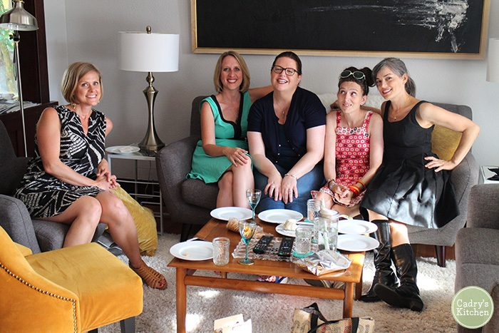 Kristy Turner, Cadry Nelson, Kristina Sloggett, Kittee Berns, and Julie Hasson in living room.