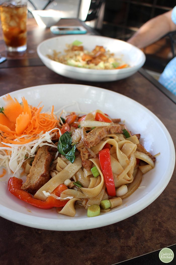 Spicy Thai basil noodles in bowl on table.