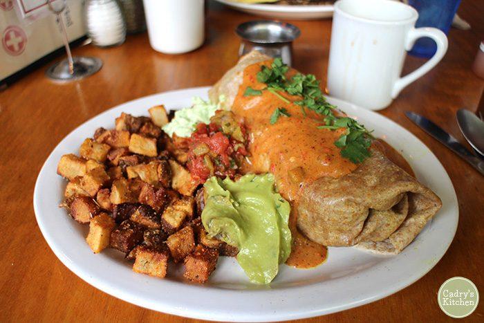 Breakfast burrito with guacamole & potatoes.