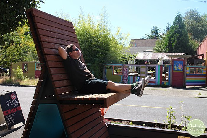 David lounging in oversized deck chair.
