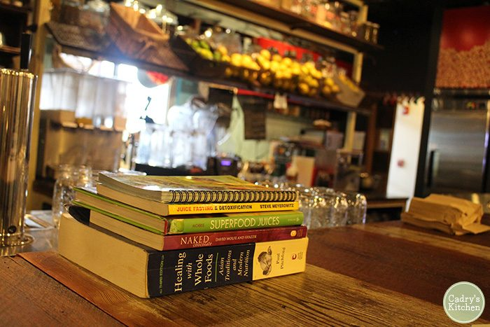 Cookbooks on table at Skyebird restaurant counter.