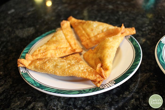 Vegan curry puffs on plate.