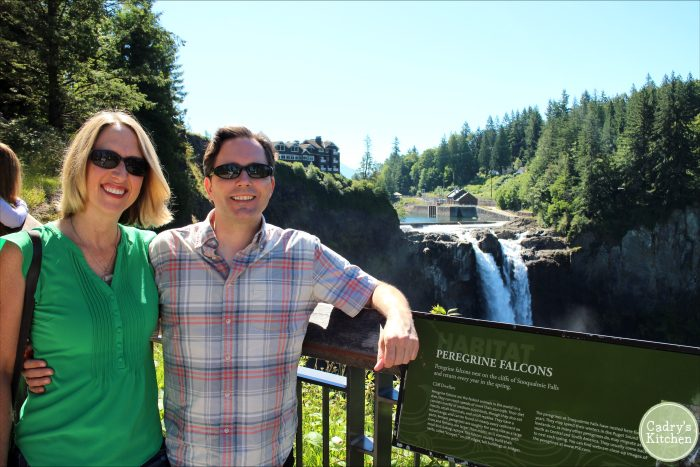 Cadry Nelson and David Busch posing in front of Snoqualmie Falls.