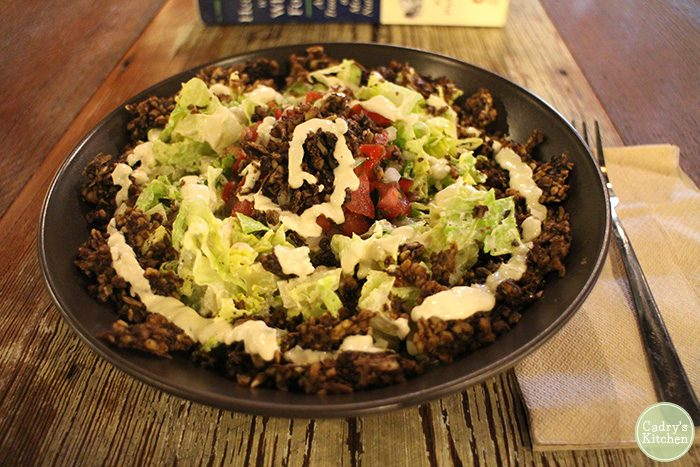 Taco salad in large black bowl at Skyebird.