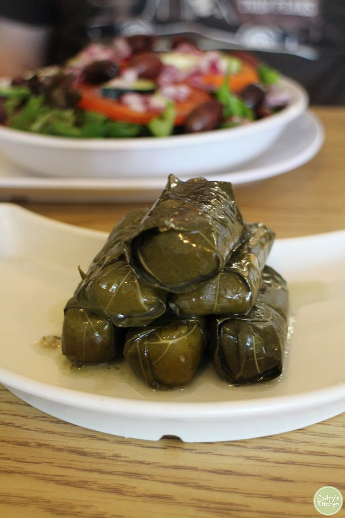 Pile of dolmas on plate.