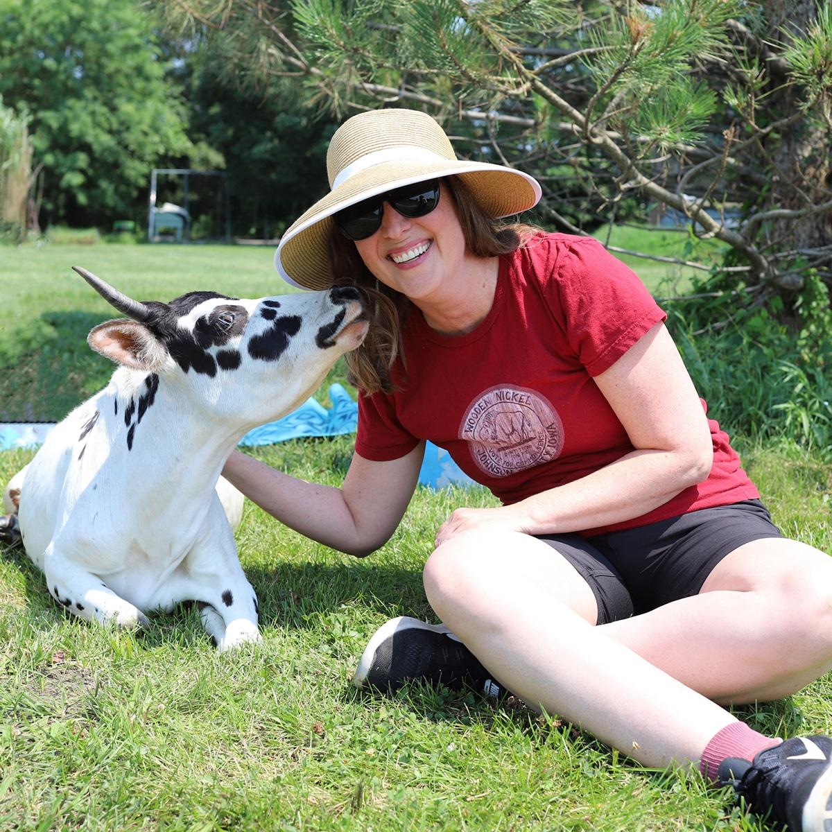 Cadry posing with rescued zebu, Angel.