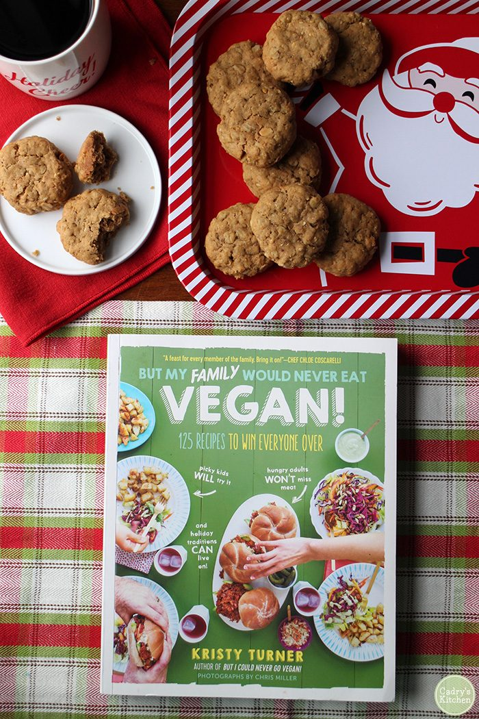 Overhead But My Family Would Never Eat Vegan cookbook & cookies on tray.