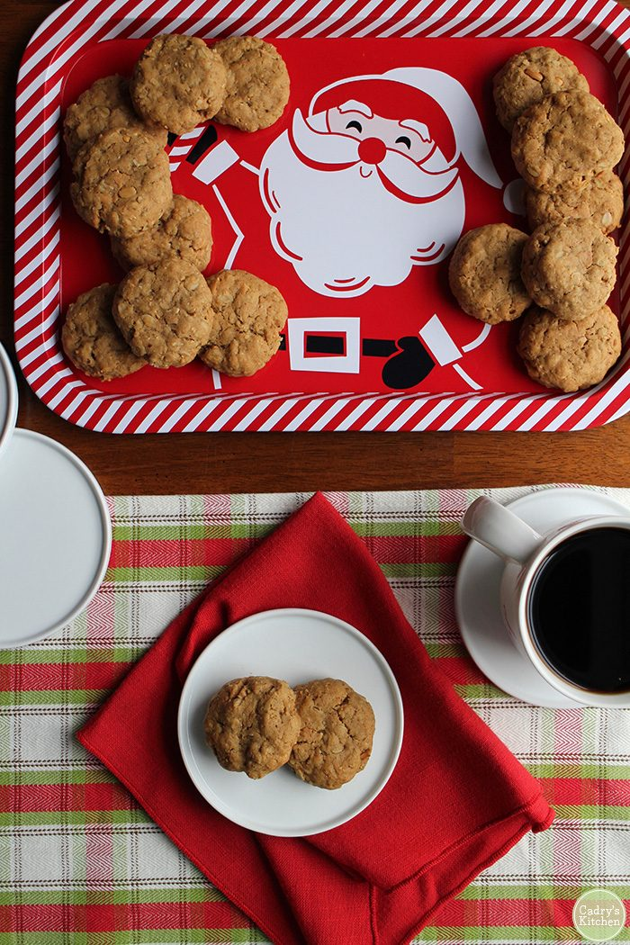 Peanut butter oatmeal cookies on Santa tray and plate with coffee.