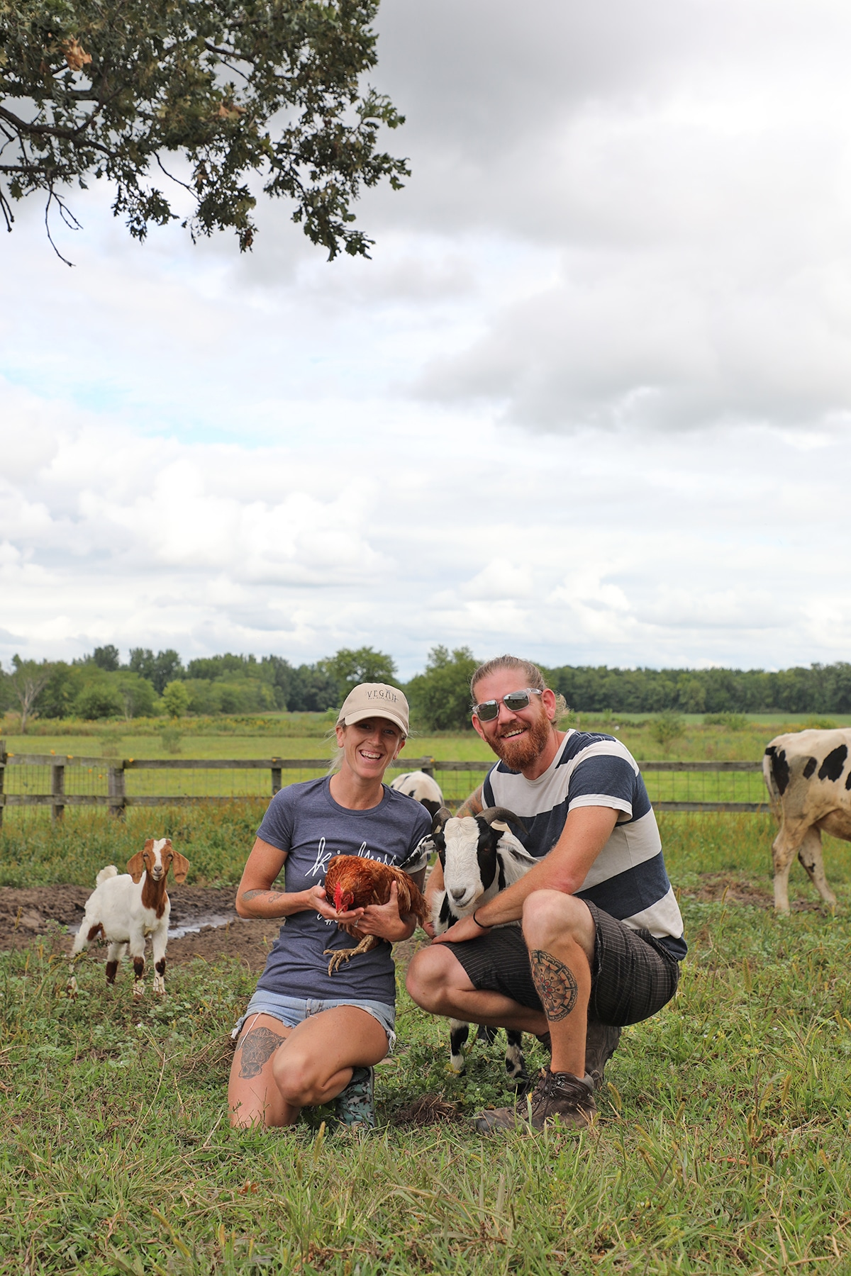 Shawn & Jered Camp standing with their rescued animal family at Iowa Farm Sanctuary.