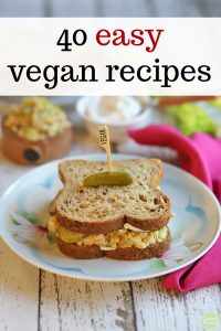 Text overlay: 40 easy vegan recipes. Chickpea salad sandwich on plate.